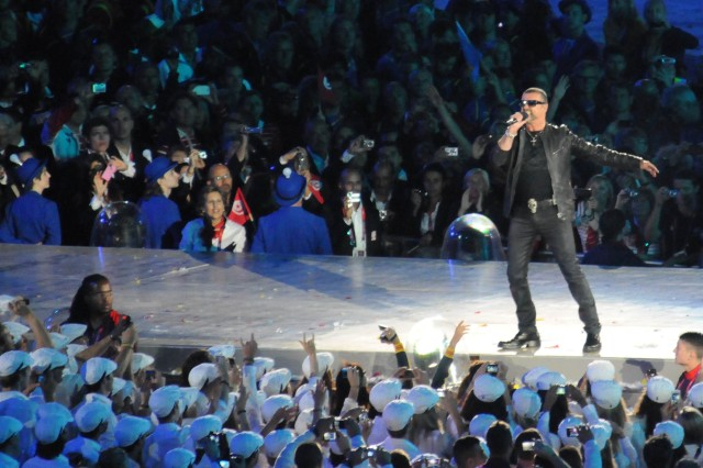 George Michael sings to a crowd of U.S. athletes in the foreground during the closing ceremony of the London 2012 Olympics, Aug. 12, 2012.
