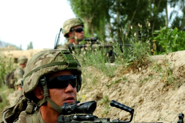 Two soldiers from 2nd Platoon, Battle Company, 2nd Battalion, 503rd Infantry Regiment, Task Force 173rd Airborne Brigade Combat Team, pull security outside the village of Yusof Khyel, Afghanistan, as part of Operation Assaly II, July 26, 2012.