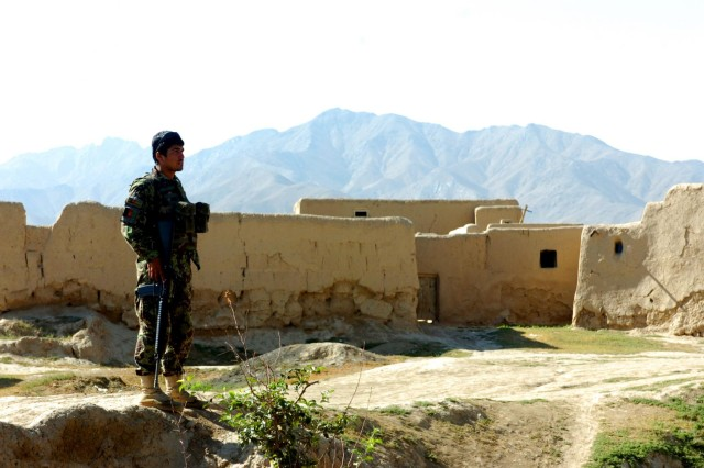 A soldier from 4th Company, 3rd Kandak, 201st Corps, Afghan National Army, stands in the village of Haft Asiab in Afghanistan's Wardak province, securing an incoming path while the rest of his element searched houses in the village during Operation Assaly II, July 27, 2012. During the operation, elements of the 3rd, 4th and Weapons Companies, 3rd Kandak, 201st Corps, ANA, led the patrols from start to finish.