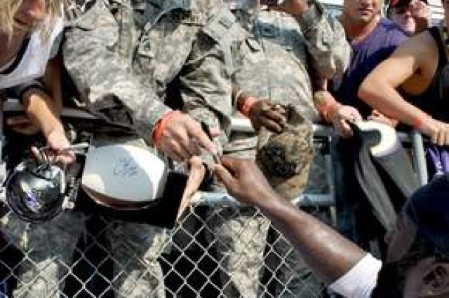 Ravens veteran All-Pro safety Ed Reed (right) signs autographs for Military District of Washington Soldiers in between drills at the team's military appreciation day Aug. 4 at Baltimore's home field, M&T Bank Stadium. The preseason practice drew servicemembers from all around the National Capital Region including Fort McNair, Fort Meade and the Aberdeen Proving Grounds.