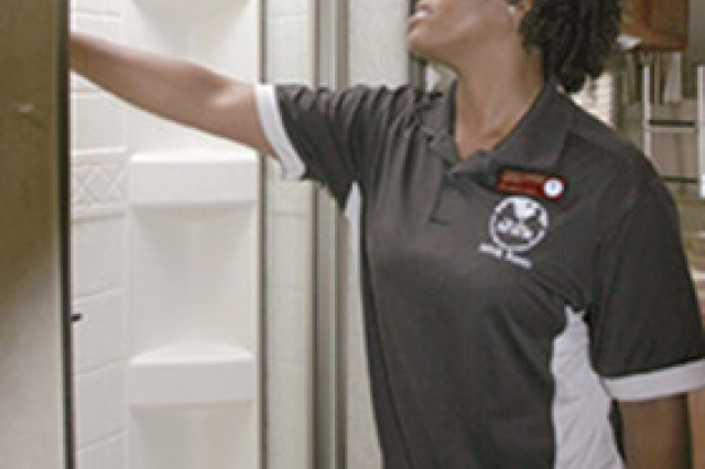 Chassity Barringer, lead recreation assistant, checks the shower and other amenities after this 2011 RV was returned from being rented for the weekend.