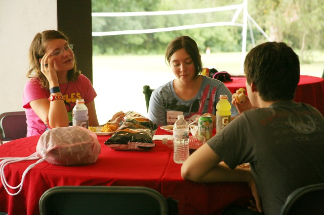 Aedon, Veronica and Elizabeth Crouse, surviving children and siblings, eat lunch during the Survivor Outreach Services summer bash at the Family Morale, Welfare and Recreation building Aug. 4.
