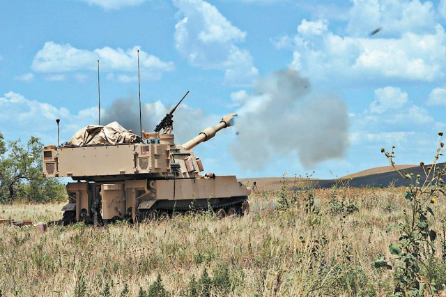 A 155mm round is fired from an M109A6 Paladin as Soldiers from A Battery, 1st Battalion, 17th Field Artillery conducted a live-fire, semi-annual qualification exercise at Fort Sill, Okla., July 24, 2012. The event was the culmination of a two-week section-certification for the artillerymen on the Paladin weapon system.