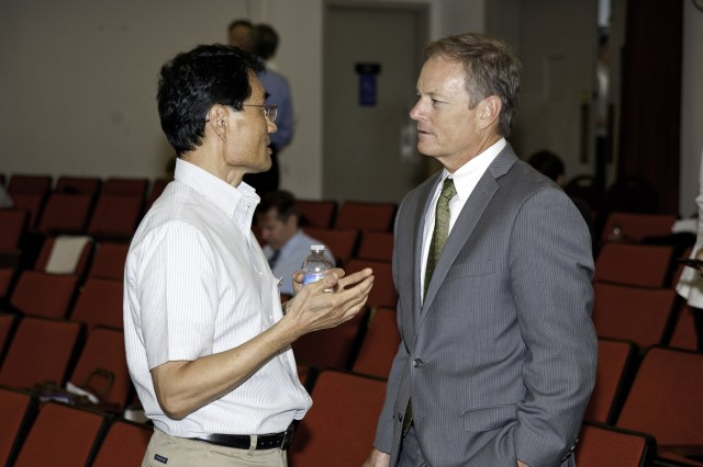 Richard Jow, Sensors and Electron Devices Directorate, U.S. Army Research Laboratory, speaks Dr. Scott Fish, the Army's chief scientist at the Enterprise for Multiscale Research of Materials kick-off meeting that began July 31, 2012 at Aberdeen Proving Ground, Md.