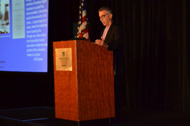 Dr. Thomas Scalea, physician-in-chief of the University of Maryland Shock Trauma Center, Baltimore, Md., presents his thoughts on military-civilian partnerships in trauma care at the 2012 Military Health System Research Symposium in Fort Lauderdale, Fla., Aug. 13, 2012.