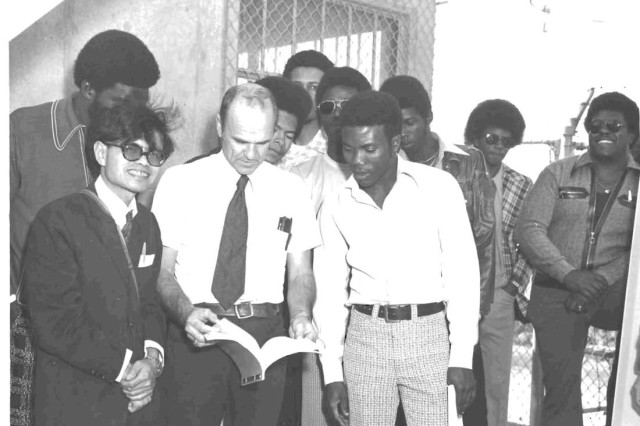 Clark M. Colquitt (second from right), a civil engineer in the U.S. Army Corps of Engineers Galveston District's Engineering and Construction Division, poses with a group of his peers from Prairie View A&M University during a recruitment visit in 1974.