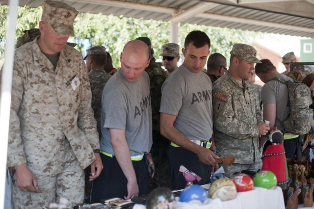 U.S. service members browse collectables, various foods, and clothing for cultural day at Thebephatshwa Air Base in the Republic of Botswana, Aug. 5, 2012. Cultural day allowed soldiers, Marines, airmen, and sailors operating in Southern Accord 2012 to interact with members of the Botswana Defense Force and local civilians in the community. (U.S. Army photo by Sgt. Adam Fischman)