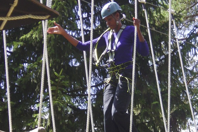 Danielle Brooks, project engineer, conducts final inspection of the high ropes course in Grafenwoehr, Germany, July 18, 2012.