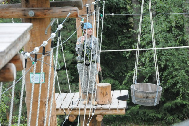Lt. Col. Michelle Garcia, U.S. Army Corps of Engineers Europe District deputy commander, was among the participants negotiating the high ropes course and celebrating the opening in Grafenwoehr, Germany, July 18, 2012.