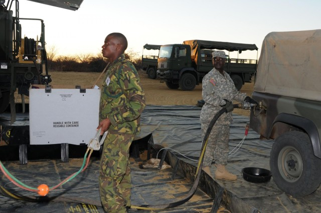 Pfc. Ronnie Okello of Aurora, Ill., a fuel handler with Company A, 405th Brigade Support Battalion, Illinois Army National Guard, fuels a vehicle for the Botswana Defense Force during Operation Southern Accord 2012. Okello, a native of Uganda, is in Botswana participating in SA12, which is an annual combined, joint exercise which brings together U.S. military and BDF personnel to conduct humanitarian assistance/disaster relief operations, peacekeeping operations and aeromedical evacuation to enhance military capabilities and interoperability.