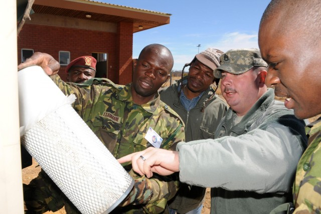 Staff Sgt. Mark Haberland of Morton, Ill., water purification supervisor with Company A, 405th Base Support Battalion, out of Streator, Ill. explains the tactical water purification system to members of the Corps of Engineers of the Botswana Defense Force on Thebephatshwa Air Base, Botswana, Aug.8. The 405th is in Africa as part of Southern Accord 2012 an annual combined, joint exercise that brings together U.S. military, BDF personnel to conduct humanitarian assistance and disaster relief operations, peace keeping operations and aeromedical evacuation to enhance military capabilities and interoperability.