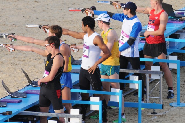 Spc. Dennis Bowsher (far right) takes aim in the laser-pistol portion of the Olympic Men's Modern Pentathlon Aug. 11, before making the cross-country run through Greenwich Park. The pentathlon also features epee fencing, a 200-meter freestyle swim and horseback show jumping.