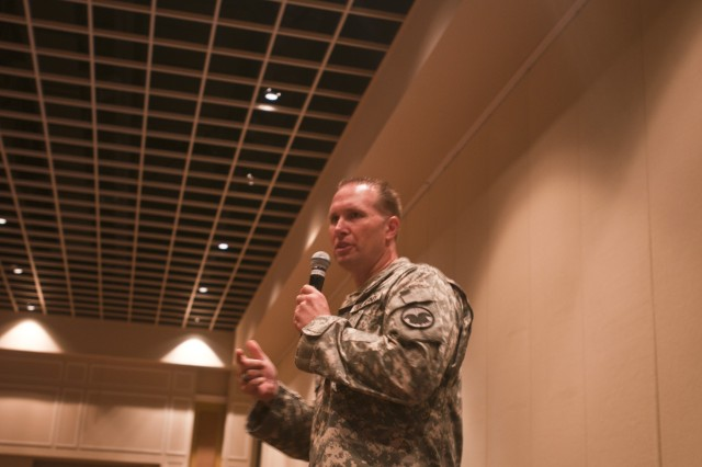 Command Sgt. Maj. Mike Schultz, the Command Sgt. Maj. of the U.S. Army Reserve Command, addresses the audience ata Yellow Ribbon Reintegration event in Orlando, Fla., August 11.