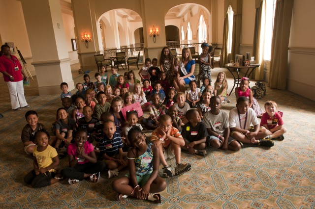 "Miss North Carolina, Arlie Honeycutt, met with military children at a Yellow Ribbon Reintegration event in Orlando, Fla., August 11. She read a couple stories to the youngest group, pictured here, and with the older group she answered questions about the Miss America program and what it is to be Miss North Carolina. ""It was so exciting to get to know so many of our service members, to get to interact with their kids and their families,"" she said."