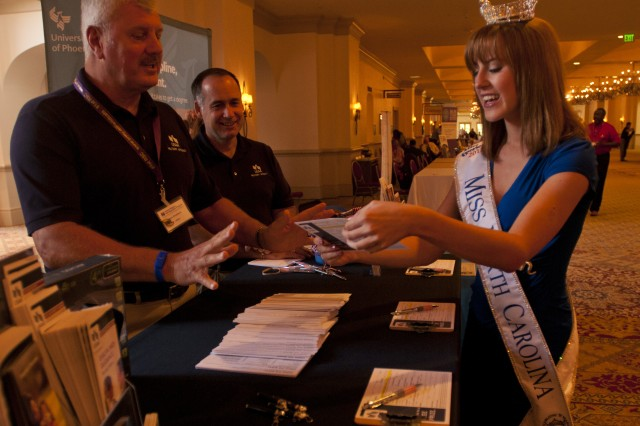Miss North Carolina, Arlie Honeycutt, draws the name of a Soldier at a Yellow Ribbon Reintegration event in Orlando, Fla., August 11. The Soldier won a prize from USAA.