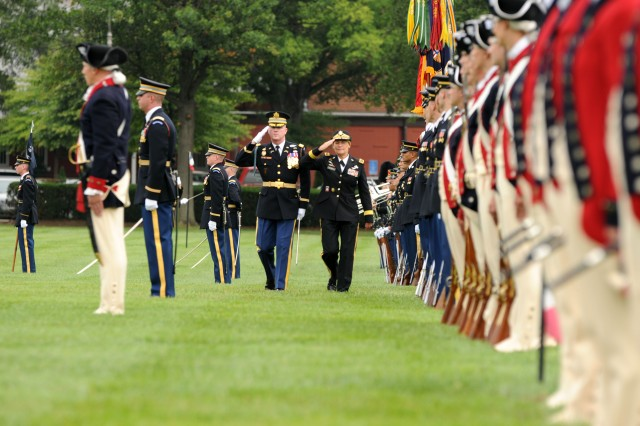 Soldiers from the 3d U.S. Infantry Regiment (The Old Guard), stand at attention as Col. James C. Markert, Regimental Commander, and U.S. Army Gen. Ann E. Dunwoody, former Commanding General, Army Material Command, conduct an inspection of troops during Dunwoody's retirement ceremony, Aug. 15, at Joint Base Myer-Henderson Hall, Va. The Old Guard is the official escort to the President of the United States and the Army's oldest active infantry regiment. They regularly conduct ceremonies and special events in support of the U.S. Army. (U.S. Army Photo by Staff Sgt. Benjamin Navratil)