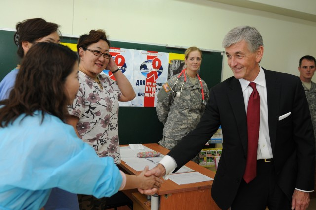 Secretary of the Army John M. McHugh greets Mongolian physicians at the medical clinic during his visit of the various Khaan Quest 12 exercise locations in and around Ulaanbaatar, Mongolia, Aug. 14, 2012. Khaan Quest is a regularly scheduled, multinational exercise sponsored by the U.S. Army Pacific and hosted annually by the Mongolian Armed Forces.