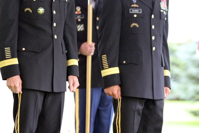 Lt. Gen. Joseph L. Votel, left, commander of Joint Special Operations Command, stands with Brig. Gen. Richard D. Clarke, deputy commanding general - operations for 10th Mountain Division (LI), after promoting him during a ceremony Friday at LeRay Mansion.