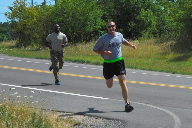 Two Soldiers assigned to 3-85th Mountain Infantry (WTU) race toward the finish line in the final leg of the Fort Drum triathlon.