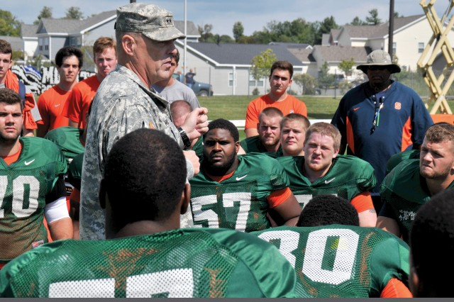 Maj. Gen. Mark A. Milley, Fort Drum and 10th Mountain Division (LI) commander, gives players a pep talk Monday on Syracuse University football's first day of training on post ahead of its season opener Sept. 1.