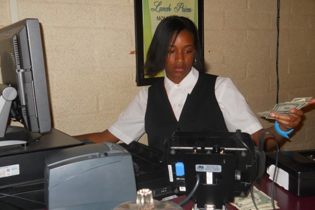 """Brooklyn Jenkins, a HIRED! Apprenticeship Program participant, spent a 12-week summer term experiencing nearly every facet of the Thunder Mountain Activity Centre operation. Her supervisor, James Howie, said she was so proficient with money that she """"did not lose a dime"""" during the three weeks she was assigned to the lunch buffet cash register."""
