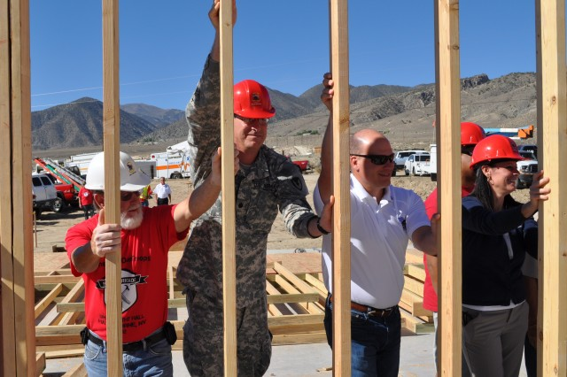 Lt. Col. Craig M. Short, commander at Hawthorne Army Depot, second from left, helps other volunteers put up walls at house-raising for wounded warrior Tim Hall in Hawthorne, Nev.