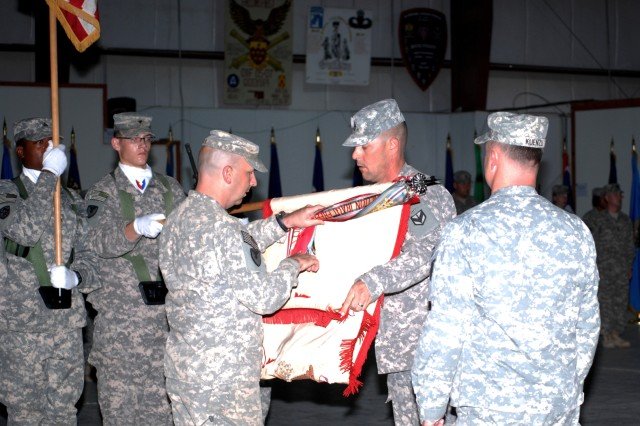 Lt. Col. William Cain Jr. (left), commander, 541st Combat Sustainment Support Battalion, and Command Sgt. Maj. Bryan Witzel, prepare the 541st CSSB flag for casing during a ceremony Aug. 6, at Camp Arifjan, Kuwait. Col. John D. Kuenzli, commander, 402nd Army Field Support Brigade, Kuwait, observes. (Photo by Johnnie Frazier, 402nd AFSB Public Affairs)