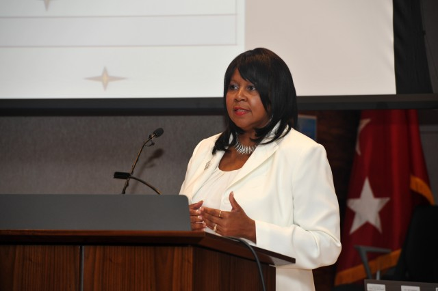 Vicki Brown, chief of Civilian Training and Leader Development, Army G3/5/7, answers a question about Army civilian training during the annual Civilian Training and Leader Development Symposium.