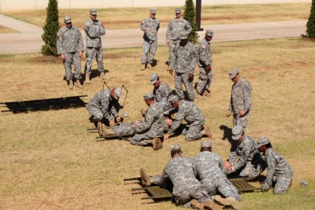 Soldiers of 3rd Training Support Battalion, 290th Regiment, 479th Field Artillery Brigade, Division West, compete to evacuate simulated casualties from the battlefield during Combat Lifesaver training last month in Oklahoma City. Two senior noncommissioned officers from Medical Training Task Force, 479th Field Artillery Brigade, Division West, conducted the training. (Photo by Capt. Bradley Mattison, 479th Field Artillery Brigade, Division West)