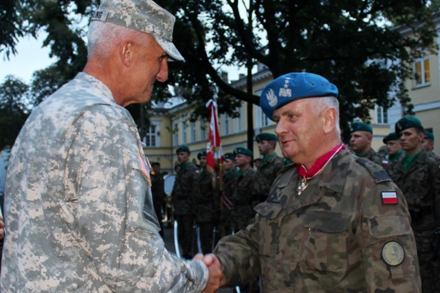 Lt. Gen. Zbigniew Glowienka, Commander of the Polish Land Forces, receives the Legion of Merit from U.S. Army Europe Commander Lt. Gen. Mark P. Hertling.