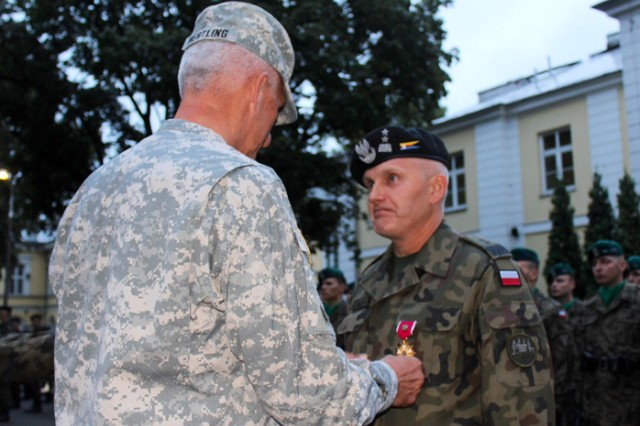 Maj. Gen. Jerzy Biziewski, Commander of the Polish 2nd Mechanized Corps, receives the Legion of Merit from U.S. Army Europe Commander Lt. Gen. Mark P. Hertling.