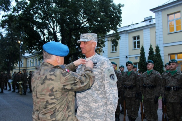U.S. Army Europe Commander Lt. Gen. Mark P. Hertling receives Gold Medal of the Polish Armed Forces from Lt. Gen. Zbigniew Glowienka, Commander of the Polish Land Forces.