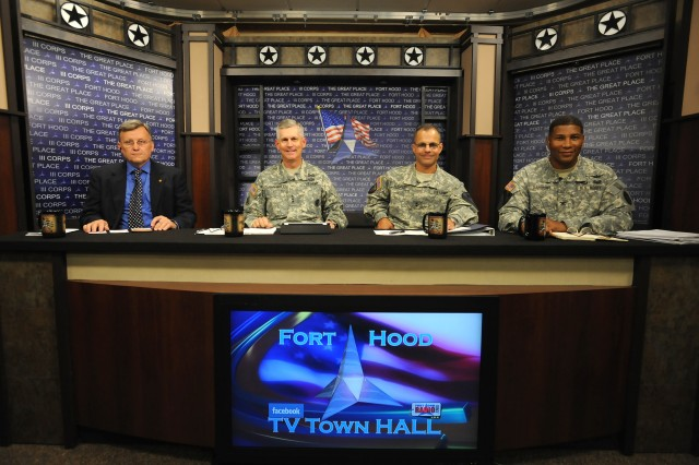Andy Bird, Fort Hood deputy garrison commander; Lt. Gen. Don Campbell Jr., III Corps and Fort Hood commanding general; Maj. Gen. Anthony Ierardi, 1st Cavalry Division commanding general; and Col. Patrick Sargent, Carl R. Darnall Army Medical Center commander, pose for a photo before the start of the Fort Hood Facebook and TV Town Hall in the Phantom Warrior Studio at III Corps Headquarters on Fort Hood, Texas, Aug. 14, 2012.