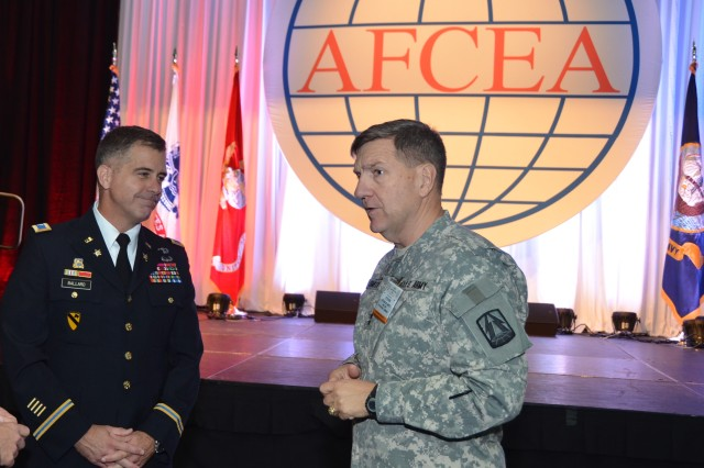 Col. Christopher S. Ballard, Army Cyber G-3, discusses leadership development with Maj. Gen. Steven W. Smith, assistant chief of staff, G-6, U.S. Army Central, 3rd Army and commanding general, 335th Signal Command (Theater). Ballard and Smith presented separately to audiences at the AFCEA TechNet Land Forces East conference in Baltimore, Aug. 14, 2012.