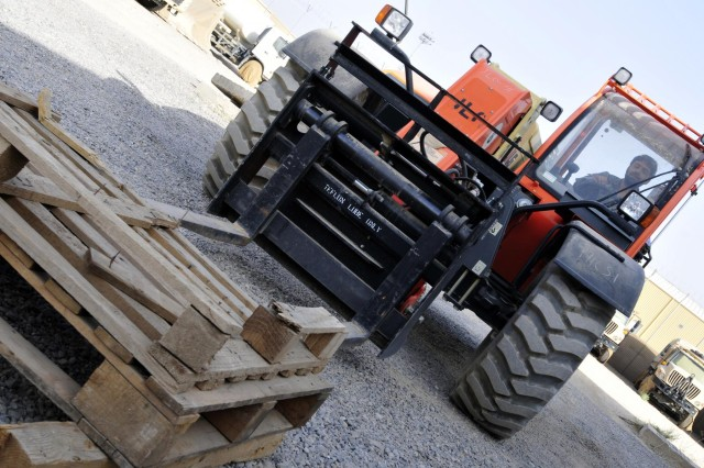 Afghan Staff Sgt. Yousif, a mechanic with the Kandahar Air Wing, maneuvers to lift some pallets using a 6K forklift during forklift training taught by soldiers from Headquarters Support Company, 209th Aviation Support Battalion, 25th Combat Aviation Brigade on Kandahar Airfield, Afghanistan, Aug. 11.