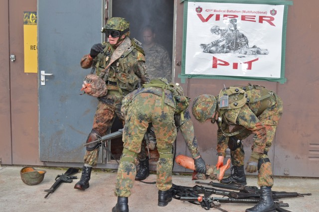 German Reserve Soldiers exit the Viper Pit after providing combat lifesaver aid under simulated fire.