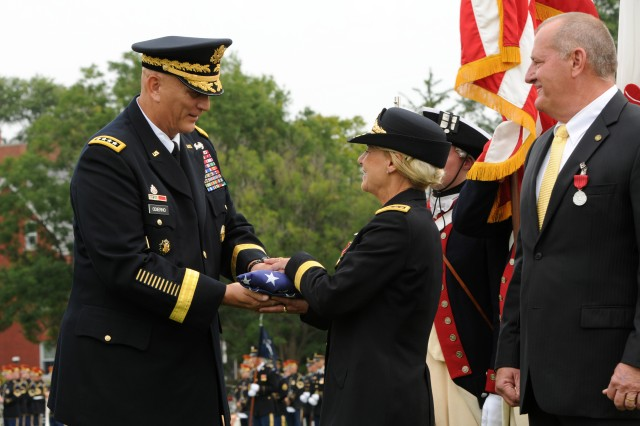 U.S. Army Chief of Staff Gen. Raymond T. Ordierno presents U.S. Army Gen. Ann E. Dunwoody, former Commanding General, Army Material Command, with a flag in honor of her 38 years of service, Aug. 15, at Joint Base Myer-Henderson Hall, Va. Dunwoody became the Army's highest-ranking female after receiving her third star in 2005. In 2008, Dunwoody became the first woman in U.S. military history to achieve a fourth star.