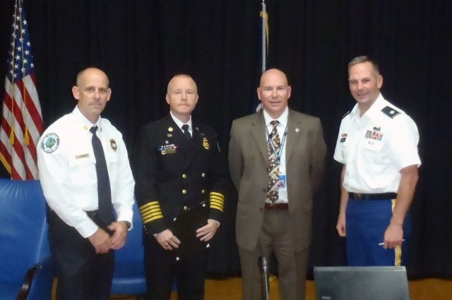 The mutual aid agreement between Fort A.P. Hill and Caroline County was signed on August 14, 2012. From left to right; Caroline County Fire Chief Loftus, Fort A.P. Hill Fire Chief Daniel Glembot, Caroline County Administrator Charles Culley and Garrison Commander Peter E. Dargle.