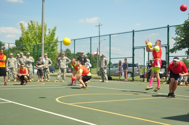 Fort Campbell, KY- The Strike Force Dodge Ball team representing the 2nd Brigade Combat Team, 101st Airborne Division (Air Assault), stand readily alert as they take on a barrage of dodge balls from the opposing team at the Week of the Eagles 2012 Dodge Ball Tournament championship game, Aug. 15 at Fort Campbell. The Strike Soldiers compete for the first championship for the new event introduced to this Week of the Eagles.