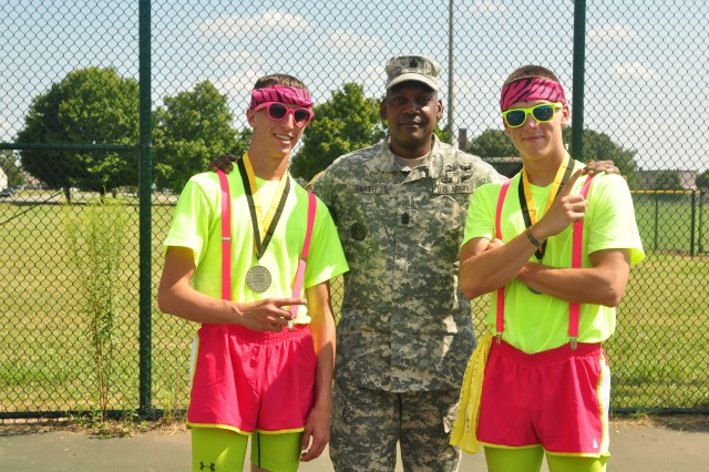 Fort Campbell, KY- Two Strike Soldiers with 2nd Battalion, 502nd Infantry Regiment, 2nd Brigade Combat Team, 101st Airborne Division (Air Assault), pose with Command Sgt. Maj. Alonzo J. Smith, command sergeant major of the 101st Airborne Division and Fort Campbell, after winning the first ever dodge ball tournament event during the Week of the Eagles, Aug. 15. The Soldiers dressed in colorful outfits during the 3-day competition.
