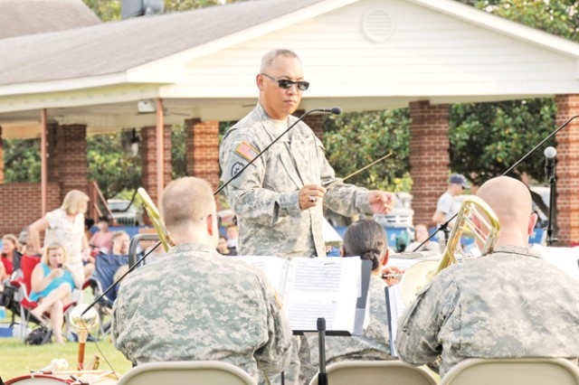 "CW4 Jesse Pascua, 98th Army ""Silver Wings"" Band commander, conducts the band during the Music Under the Alabama Stars concert series at Howze Field June 22 to celebrate the Army's 237th birthday."