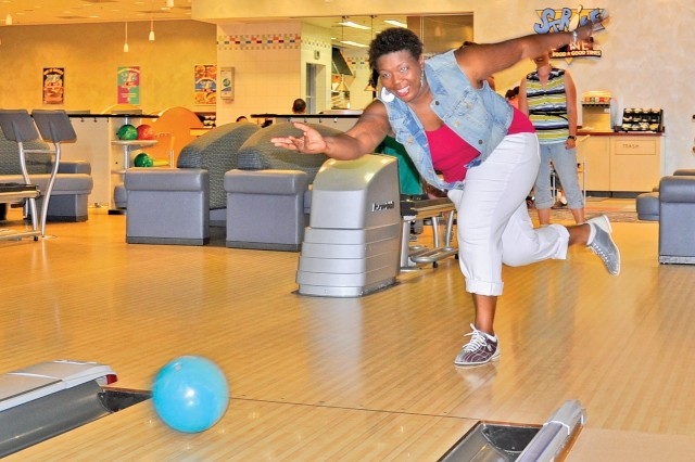 Priscilla Washington, a V Corps spouse, bowls at the Wiesbaden Entertainment Center during a V Corps Family Readiness Group outing July 27.