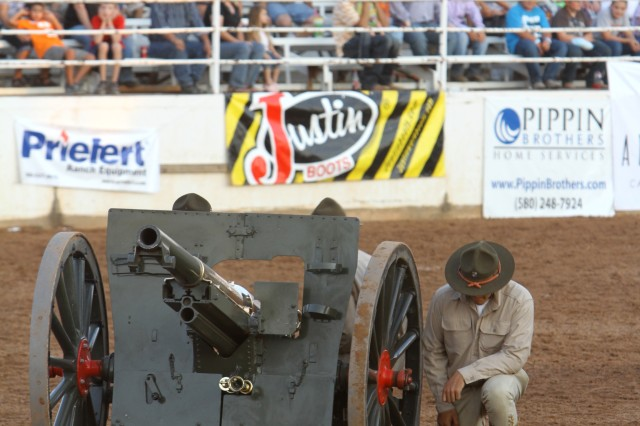 Members of the Fort Sill Field Artillery Half-Section get ready to fire their cannon during their performance at the Lawton Rangers Rodeo Aug. 11.
