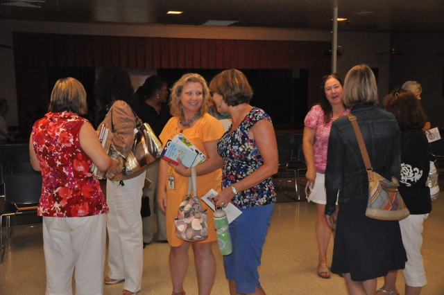 Teachers mingle after Monday's 'opening ceremonies' celebration at C.C. Pinckney Elementary School, which kicked off the start of the new school year.