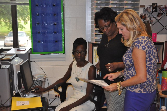 From left, substitute Stephanie Anderson and teachers Patricia Walters and Macie Fitzgerald prepare for a new school year Wednesday at C.C. Pinckney Elementary.
