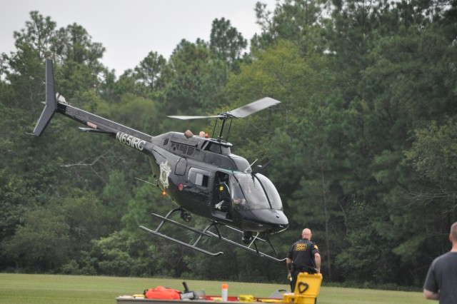 A Richland County Sheriff's Department helicopter lifts off at Hilton Field Aug. 9, as part of Fort Jackson's National Night Out. The helicopter is used for aerial surveillance. The event increased awareness of crime prevention and gave families the opportunity to meet with local and state law enforcement officers.