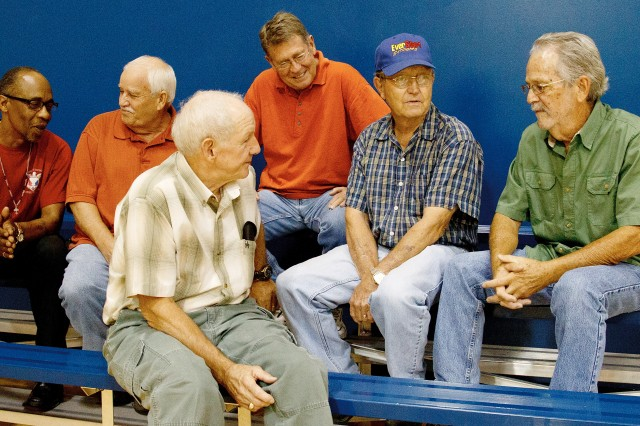 Eighteen Anniston Army Depot employees have more than 40 years of service. Here, Lawrence Gable, Robert Nabors, Paul Bonds, Bruce Windom, Charlie Brady and Charles Word reminisce about the way the depot was when their careers began.