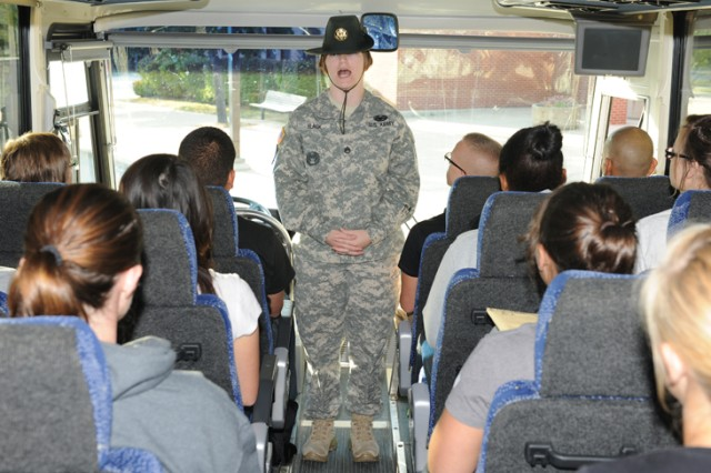 Staff Sgt. Amanda Black, 43rd Adjutant General Battalion drill sergeant, gives instructions to new arrivals for Basic Combat Training at Fort Leonard Wood, Mo., prior to their departing off the bus.
