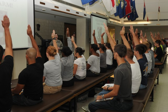 At Basic Combat Training at Fort Leonard Wood, Mo., Soldiers are instructed on basic fundamentals at the reception station to include how to raise your hand to ask a question.