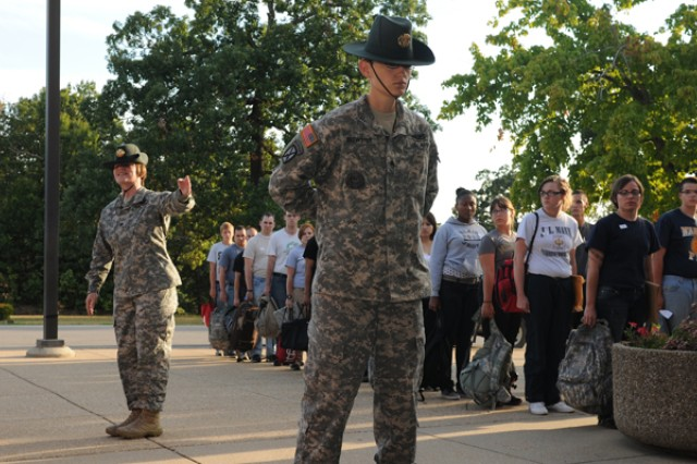 Staff Sgt. Amanda Black instructs newly-arrived Soldiers at Fort Leonard Wood, Mo., on the proper way to stand at parade rest as Staff Sgt. Jennifer Brewster demonstrates the position, Aug. 7. Both Brewster and Black are drill sergeants with the 43rd Adjutant General Battalion.